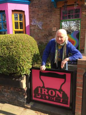 Editor Peter Mortimer. at the gate of the IRON House