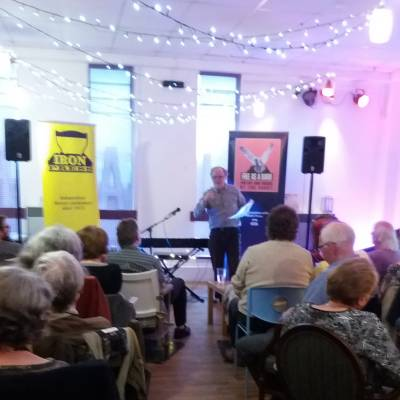 George Jowett reading at the Jam Jar Cinema Café
